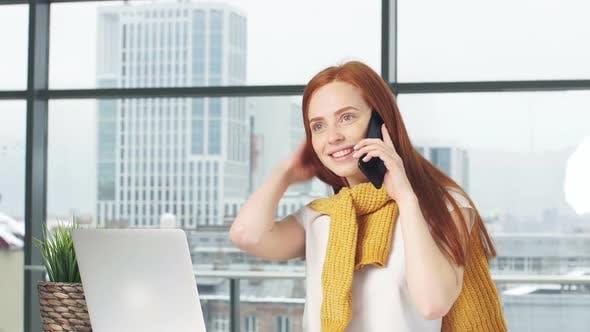 Joyful Redhead Girl Beauty Blogger Working in Office