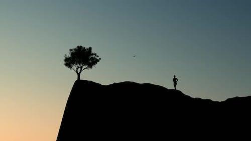 Woman Silhouette Running To The Peak