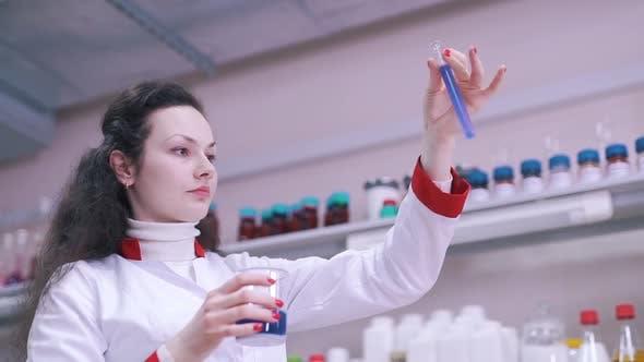 Thumbnail for a Scientist Estimates Liquid in a Test Tube