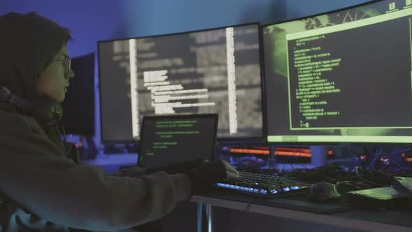 Hacker Using Multiple Computers