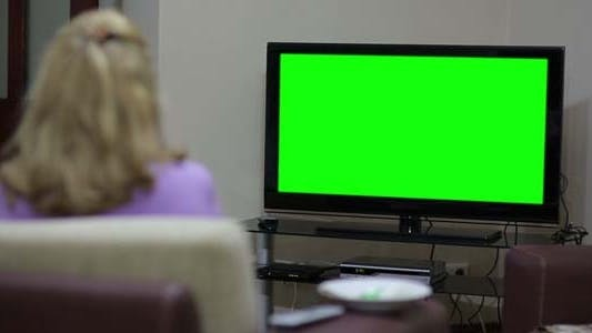 Thumbnail for Couple Sitting In Front Of Blank Green TV Screen