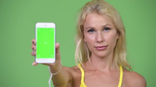 Thumbnail for Young Happy Beautiful Blonde Woman Showing Phone