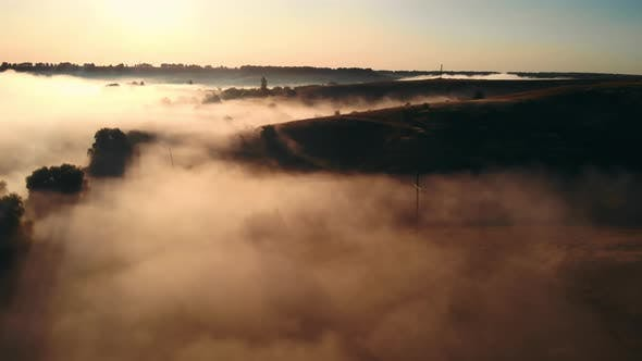 Thumbnail for Drove Flying Over Field with Fog