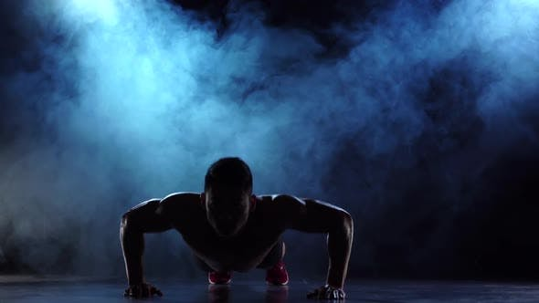 Thumbnail for Weightlifter Is Exercising, Shaking His Hands From the Floor, Black Smoke Background, Silhouette