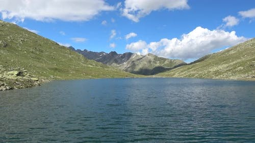Scenic view on peak of mountains and lake in Swiss Alps