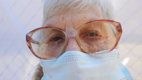 Close Up Face of Granny in Protective Mask From Virus