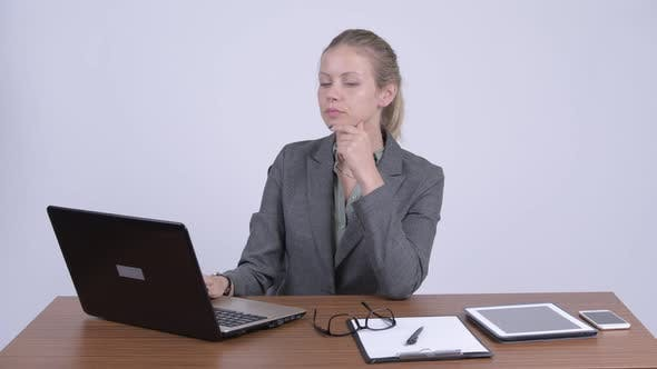 Thumbnail for Young Beautiful Blonde Businesswoman Using Laptop and Looking Shocked at Work