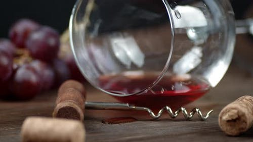 A Glass of Red Wine Is on the Table. Macro Background. High Quality  Footage