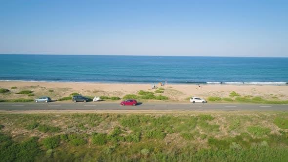 Thumbnail for Aerial Drone View of Red Car Driving Down Coast Country Road in Alepu, Sozopol, Bulgaria
