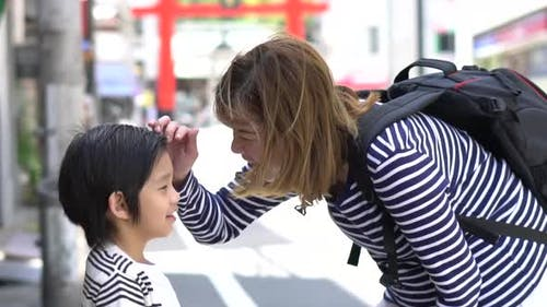Asian Mother Talking With Her Son While Travel In Japan