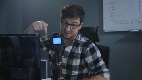 Man Recording a Vlog in Office
