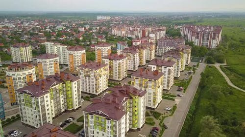 Aerial view of city residential area with high apartment buildings.