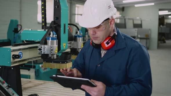The Operator of the CNC Machine