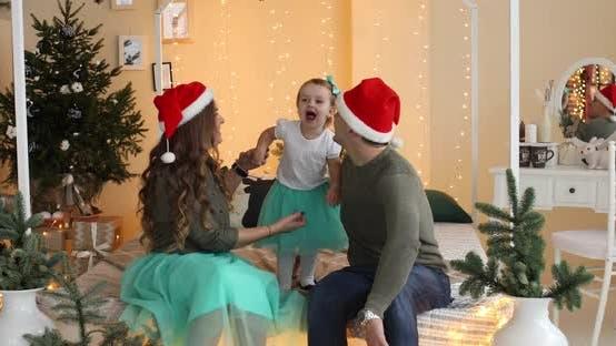 Family in Santa Hats at Home.