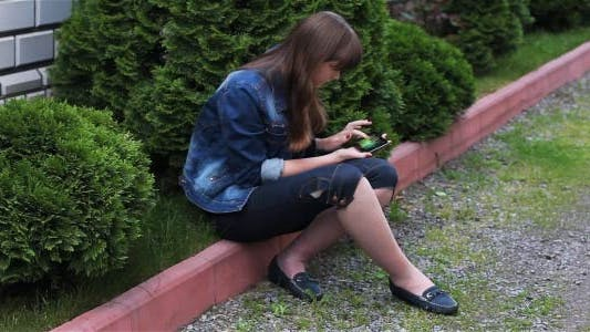 Thumbnail for Girl With Mobile Phone In The Garden 4