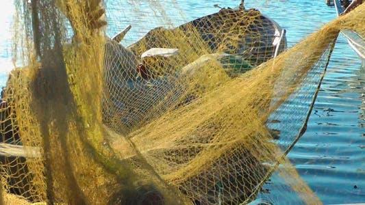 Thumbnail for Fishermen Repairs Fishnets
