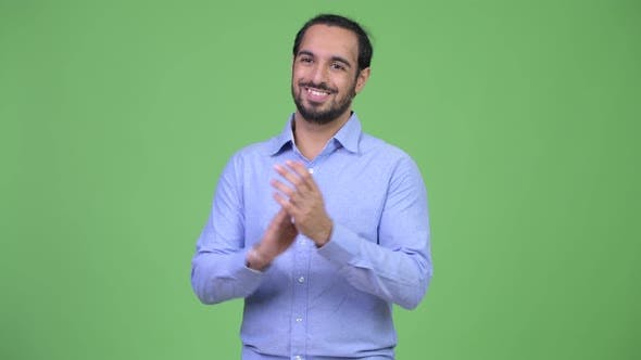 Young Happy Bearded Indian Businessman Clapping Hands and Thinking