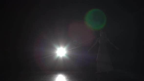 Thumbnail for Motion of a Beautiful Woman Dancing Contemporary in Dark Studio