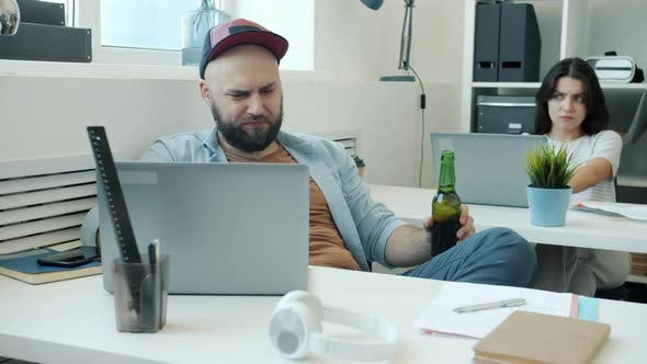 Carefree Man Drinking Alcohol at Work Fighting with Colleague Then Sleeping