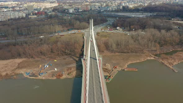 Thumbnail for Aerial Drone Flight Footage of a Bridge with Car Traffic Surrounded By Beautiful City Landscape