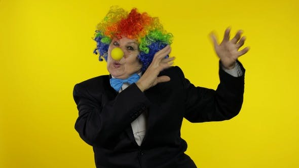 Thumbnail for Senior Old Woman Clown in Wig Having Fun, Smiling, Dancing, Making Silly Faces
