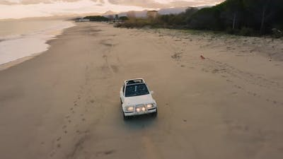 White Jeep off road in the beach