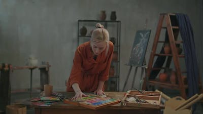 Artist Choosing Color From Set of Multicolored Pastel Crayons