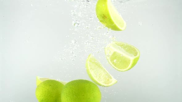 Limes Falling into Water 01