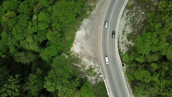 Aerial Top Down  View of Car Driving on Rural Road in Forest