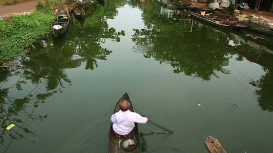 Thumbnail for Local Man Paddling On Canal In Kerala