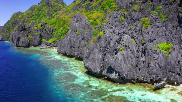 Cover Image for Clear Waters and Jagged Limestone Cliffs of Matinloc Island at Palawan, Philippines