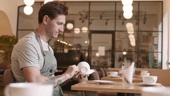 Thumbnail for Caucasian Waiter Wiping Cup by Table
