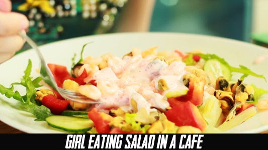 Thumbnail for Girl Eating Salad In A Cafe
