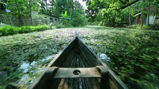 Thumbnail for Boat Moving Along Canal At Sunset In Kerala
