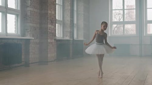 Little Ballerina Doing Pirouettes Dancing In Studio