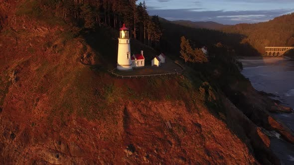 Aerial shot of Heceta Head Lighthouse at sunset, Oregon