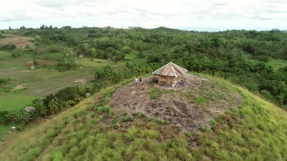 Thumbnail for Aerial view couple on the top of Chocolate Hills Complex, Batuan, Philippines.