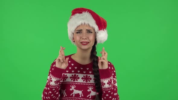 Thumbnail for Portrait of Sweety Girl in Santa Claus Hat Is Looking at Camera with Anticipation, Then Very Upset