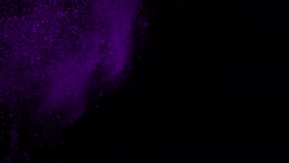 Explosion of Purple Glittering Particles