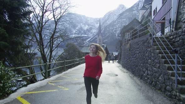Thumbnail for Woman running on the street in Hallstatt