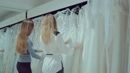 Bride and Girlfriend Choose a Wedding Dress in the Cabin