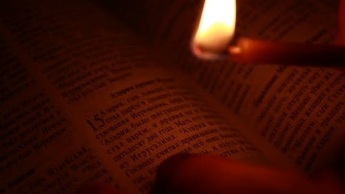 Burning Candle on a Bible