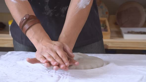 Thumbnail for Female Sculptor Is Pugging and Kneading Clay for Creating Pottery Ceramics. Art and Handicraft