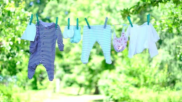 Thumbnail for Baby Clothes on Clothesline in Garden