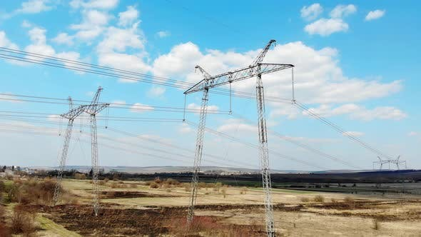 Aerial View Long-distance Power Transmission Lines. High-voltage Poles That Efficiently Transmit
