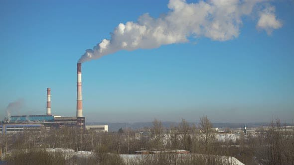Thumbnail for Time Lapse, Pipes with Smoke of Thermal Power Station in Winter at Beautiful Sunny Day.