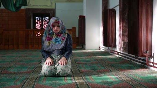 Thumbnail for Muslim Girl Saying Her Everyday Salat Prayer