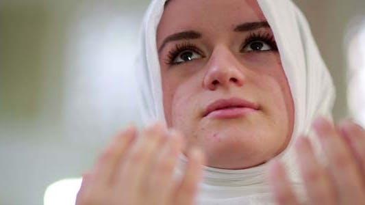 Thumbnail for Muslim Girl Saying Salat Prayer In Mosque