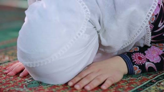 Thumbnail for Young Muslim Girl Reading Quran In Mosque