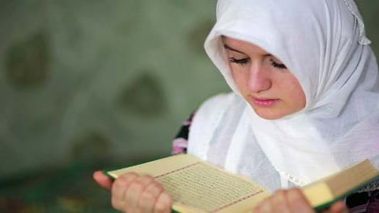 Thumbnail for Muslim Girl Praying In Small Graveyard